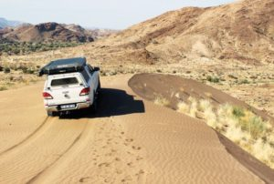 Nick Yell follows the track-testing footprints in the Mazda BT-50 on one of the dunes at Vaalsand