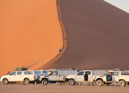 Cars at the base of dune 45
